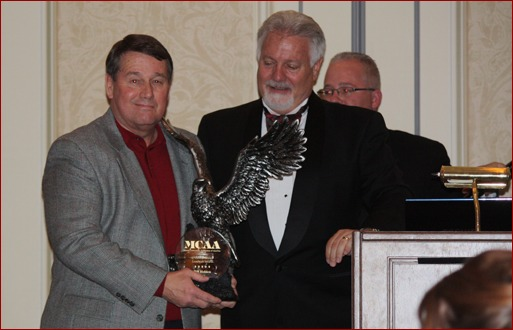 MCAA Past-President Tom Daniel presented the 2010 C. DeWitt Brown Leadman Award to Bill Holden, president of Birmingham, Ala.-based Block USA, during the MCAA Closing Banquet.