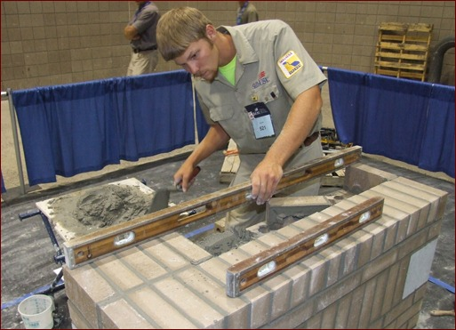This photo shows Bradley Wright working on his composite project at the 2010 SkillsUSA national masonry contest.