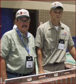 Instructor Charles West (left) with Bradley Wright (right) pose with Wright's winning composite project in the 2009 SkillsUSA national masonry contest.