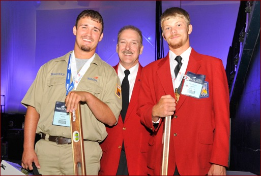 SkillsUSA Executive Director Timothy W. Lawrence gave special congratulations to the divisional winners of the 2010 national masonry competition.  Pictured backstage are secondary division winner Brandon Boldon (l), Laurence (c) and post secondary winner Bradley Wright (r), winner of three national masonry championships.
