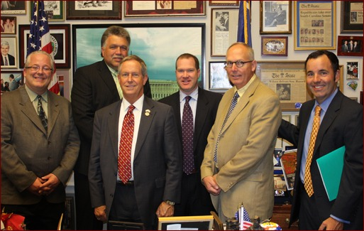 Jeff Buczkiewicz, Mackie Bounds (back row), Congressman Joe Wilson of South Carolina, Eric Dell, Paul Odom and Matt Keelen.