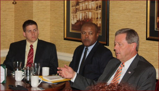 Jon Davenport, Calvin Brodie and Congressman Tom Latham meet at the Capitol Hill Club.