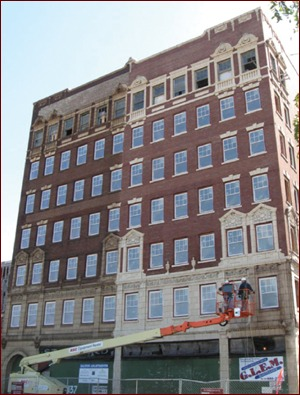 The historic masonry exterior of Dalton Apartments in Gary, Ind., gets a good cleaning with PROSOCO products as part of a restoration and rehab slated for completion by September or sooner.  Photo courtesy Midwest Pressure Washing