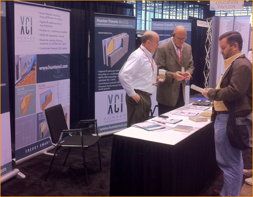 Hunter Panels talked with CONSTRUCT show attendees at their active booth.