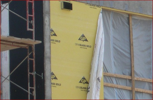Adhesion of fabric wraps can be problematic as shown here. The best fluid-applied barriers will adhere through the worst conditions, even before cladding goes up.