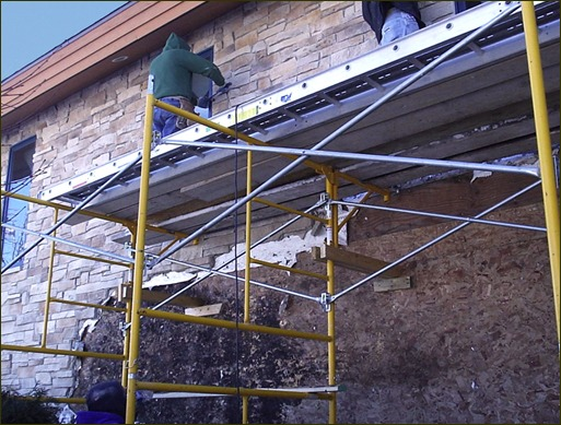 Stone veneer removal on home with entrapped moisture damage to rainscreen building envelope