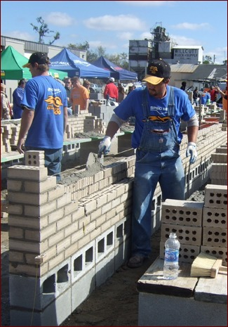 Mayes participates in a bricklaying competition.
