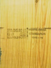 Solid sawn scaffold plank that has of mill/grade stamp and OSHA-compliant stamp.