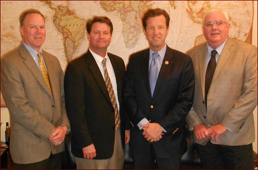 Shown are Mark Wilhhelms, David Gillick, Missouri Congressman Russ Carnahan, and John Smith.