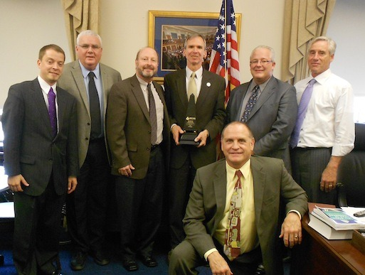 The MCAA Prosperity Award is presented to Illinois Congressman David Lipinsky. Shown are Steve Borg, John Smith, Steve Hunt, Congressman Lipinsky, Jeff Buczkiewicz, Mark Kemp, and Jim O'Connor.