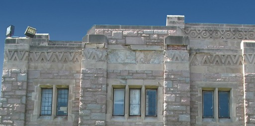 Shown is the Phi Delta Theta house at Butler University in Indianapolis with damaged limestone.