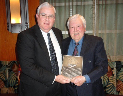 MCAA Chairman John Smith (left) presents Donald Grant with the Masonry Hall of Fame plaque.