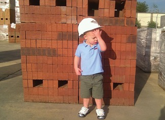 Speaking of the future of masonry, shown is my 2-year-old nephew, Rowan, on the brickyard at South Georgia Brick Co. on a hot day in Albany, Ga.