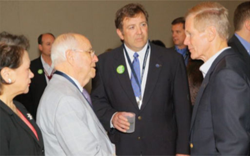 Shown is Major Ogilvie (center) introducing Sen. Bill Nelson (right) to Charles Newsome with Johnson Concrete Co. on The Hill in 2012.