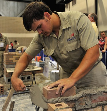 Caleb Soley, the fourth of four Soley Brothers to compete in the National Masonry Contest held in conjunction with the annual SkillsUSA Leadership and Skills Conference, works to complete his composite project this past June. Each of Porter Soley's sons placed between fourth and eight place in the national contests in which each participated.