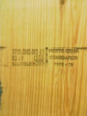 Solid sawn scaffold plank that has of mill/grade stamp and OSHA-compliant stamp