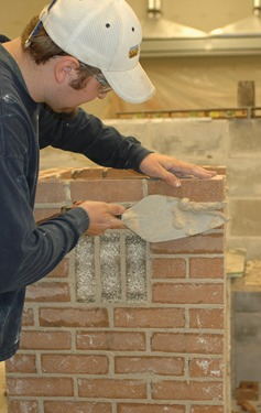 Andy Schlichte of Cedar Rapids nears completion of his masonry competition project in Jones Hall at Kirkwood Community College.