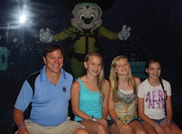 Damian Lang (left) from Lang Masonry and EZ Grout Corporation (MCAA Strategic Partner) with his daughters Amy, Aariah, and Rachel, and Mickey Mouse (center) during the MCAA Closing dinner at the Living Seas Salon at Epcot.