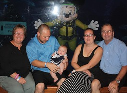 Colleen (left) from Sutter Masonry with Eric Green (left center), Kylee Green (center), Aimee Green (right center) and MCAA Treasurer Mike Sutter (right) get their picture taken with Mickey Mouse during the MCAA Closing dinner at the Living Seas Salon at Epcot.