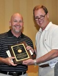 Mike Cook, company safety director, accepts the award from John Cramer on behalf of Gates Construction Co. in Mooresville.