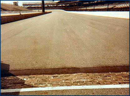 the Indianapolis Motor Speedway was surfaced with more than 3 million clay pavers before it was covered with asphalt. The original pavers still stand at the start/finish line of the track as shown.