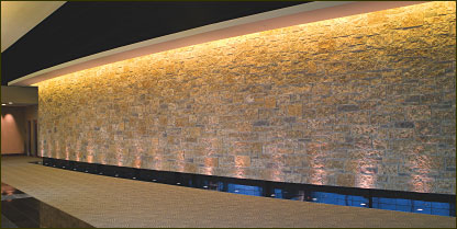 Thin stone is a perfect way to dress up and add class to the interior of any building, as shown on the hallway of Hubbell Lighting, which uses thin stone veneer from Natural Stone Veneers International.