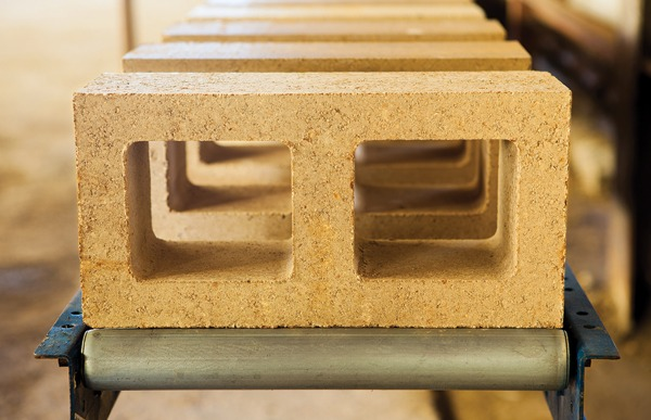 First generation Watershed Block made with half the cement of traditional concrete block and incorporating locally sourced, often recycled or repurposed unwashed aggregate. Watershed Block are engineered to meet ASTM-C90 requirements for concrete block. Image credit: ©Jacob Snavely