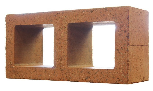 Structural masonry block made with an early prototype of an advanced mix design by Watershed Materials that uses no cement, no fly ash, no blast furnace slag and no metakaolin. This block was made with a new kind of geopolymer technology that activates naturally occurring clay minerals to fully replace cement in masonry, while still achieving high levels of performance. Early test samples achieved 7,000 psi, while offering a remarkable resistance to water and chemical erosion. Image credit: ©Watershed Materials