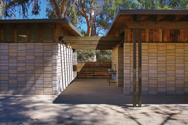 Sustainable building on the Stanford University campus that incorporates Watershed Block – a new form of structural masonry – along with reclaimed timber and barnwood siding to demonstrate the beauty and utility of wise resource reuse. The architect specified stacked bond with deeply raked horizontal joints using three different block dimensions. The Watershed Block's hue is inspired by the rich reddish-brown sandstone that underlies the Stanford campus. Image credit: ©SkyHawk Photography – Brian Haux