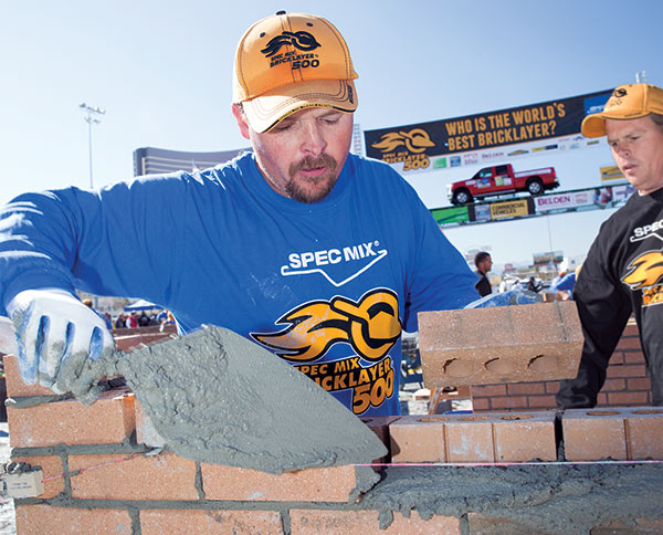 First Place winner of the SPEC MIX BRICKLAYER 500, Scott Tuttle (foreground), with his brother and mason tender, Brian Tuttle.