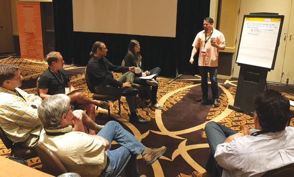 BSI 2015 president Rob Barnes, Dee Brown Co., leads the Installer Advocacy Group discussion at the recent MIA+BSI Annual Convention in Scottsdale, Ariz.