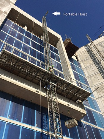 Figure 4 — Contractor on a Scanclimber SC5000 at the Westin Hotel in Sarasota, Fla., lifting stucco with Leo hoist. (Courtesy of Sunbelt Rentals)