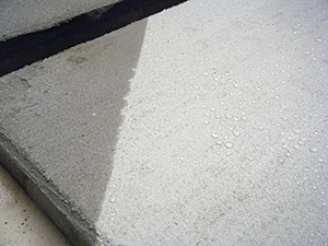 Penetrating silane-siloxane sealers, when properly balanced, allow water to bead on top of the substrate.