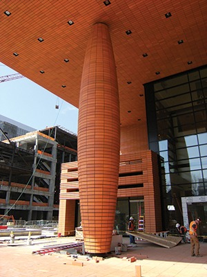 Rainsceen veneer terra cotta used alternatively to clad a column and ceiling of structure.