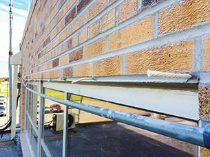 Western Specialty Contractors crews replaced all sealants on the former passenger terminal at Hector International Airport in Fargo, N.D., with 4,000 lineal feet of silicone, then thoroughly cleaned and sealed the entire building to protect it from future water damage.